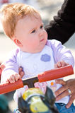 Baby at funfair. Cute baby girl at a funfair royalty free stock photos