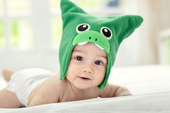 Baby with funny cap. On head Royalty Free Stock Photo