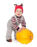 Baby in funny deer hat with orange pumpkin Stock Photography