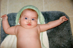 Baby with funny facial expression after a bath stock photos