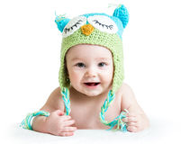 Baby in funny knitted hat owl. Baby in funny owl knitted  hat owl on white background Royalty Free Stock Photos