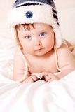 Baby in fur-cap Stock Image