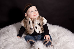 Baby in fur coat Royalty Free Stock Photo