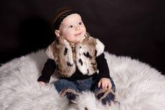 Baby in fur coat. Cute little baby in fur coat Royalty Free Stock Photo