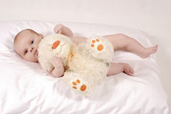 Baby with a furry teddy bear Royalty Free Stock Photos