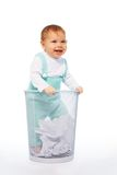 Baby in the garbage basket Royalty Free Stock Images
