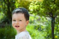 Baby in a garden Stock Photo