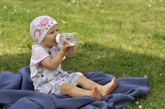 Baby in garden Stock Image