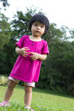 Baby in garden. Portrait of little Asian baby in garden during summer time Royalty Free Stock Image