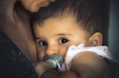 Baby gaze hug mother big eyes newborn. Baby gaze hug mother background portrait Royalty Free Stock Images