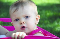 Baby Gazing up in Pink Tub. A one year old girl looking up in a pink plastic tub Royalty Free Stock Photos