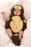 Baby gekleidet als Affe Stockbild