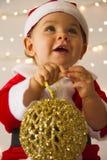 Baby gekleidet als Weihnachtsmann Lizenzfreie Stockbilder