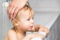 Baby get's the hair washed Stock Photo