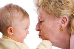Baby getting a kiss royalty free stock image