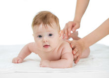 Baby getting massage on white background royalty free stock photos
