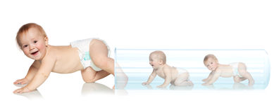 Baby getting out of the tube stock photography