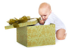 Baby with a gift Royalty Free Stock Photo