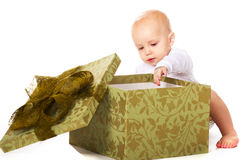Baby with a gift Royalty Free Stock Photography