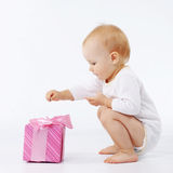 Baby with gift box Stock Images