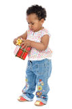 Baby with a gift box Stock Images