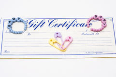 Baby Gift Certificate. Gift certificate with baby items including baby bracelets royalty free stock images
