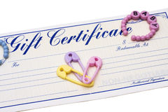 Baby Gift Certificate. Gift certificate with baby items ? baby shower gift stock photos