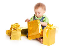 Baby with gifts. Isolated on white background stock photos
