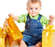 Baby with gifts Stock Images