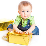 Baby with gifts. Isolated on white background royalty free stock images