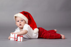 Baby with gifts. Stock Image