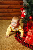 Baby gifts and Christmas tree Royalty Free Stock Photos
