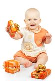 Baby with gifts Stock Photo