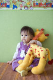 Baby with giraffe. At home stock images