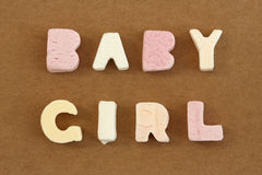 Baby Girl. Spelled in pastel colour alphabet sweets royalty free stock photos