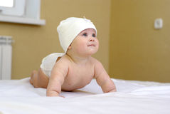 Baby girl. Happy smiling baby girl on bed Stock Images