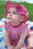 Baby Girl. Baby sitting on blanket looking up Royalty Free Stock Photo