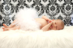 Baby girl. Newborn baby girl sleeping on her back while wearing tutu Royalty Free Stock Photo