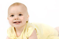 Baby Girl. Beautiful one year old baby girl in a yellow dress royalty free stock photos