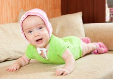 Baby girl. Portrait of cute little baby girl on sofa Royalty Free Stock Photography