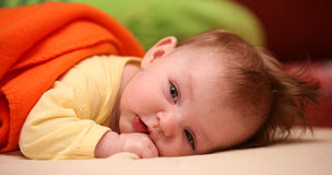 Baby girl. Small baby girl lying pron Royalty Free Stock Photography