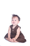 Baby Girl. With Brunette Hair Sitting smiling Stock Photo