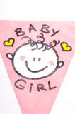 It is a baby girl!. A pink flag for baby girls first present after birth as decoration with yellow hearts and a illustration on it Stock Photo