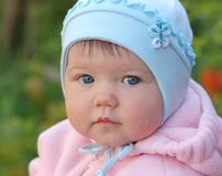 Baby girl. Portrait of beautiful baby in blue  hat Royalty Free Stock Image