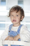 Baby girl. Little girl sitting in her chair and crying Stock Photo