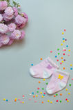 Baby girl accessories and flowers over grey background Royalty Free Stock Images