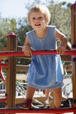 Baby girl at action-oriented playground Royalty Free Stock Photo
