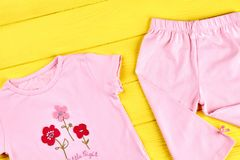 Baby-girl adorable summer apparel. Stock Images