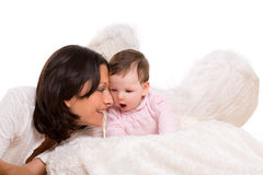 Baby girl angel with feather white wings and mother Royalty Free Stock Photos