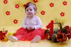 Baby girl anniversary in red and yellow decor Royalty Free Stock Photography